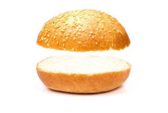 Two pieces of a hamburger bun with nothing between them.