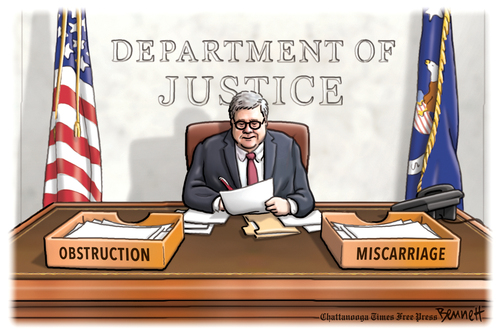 William Barr at his desk at the Department of Justice perusing documents.  On his desk are two boxes, one labeled