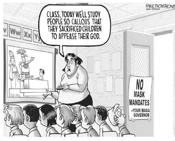 Teacher in classroom stuffed with unmasked students.  A sign on the door reads,